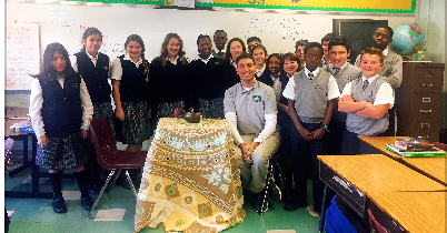 classroom posing with the peace table
